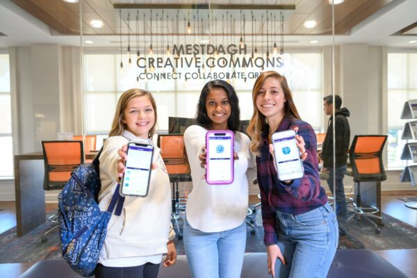 Students showing RISE App