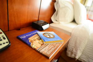 "Many of our hotel partners including Courtyard Marriott, JH Adams Inn, Wingate by Wyndham and Biltmore Suites offer the HPU Magazine and ""Choose to be Extraordinary"" books in every room for their guests."