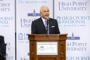 Qubein addresses community members at the event.
