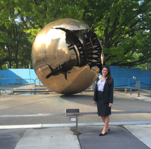 Coppa beside the Sphere Within Sphere sculpture, sculpture, a gift to the United Nations from Lamberto Dini, Minister of Foreign Affairs of Italy.