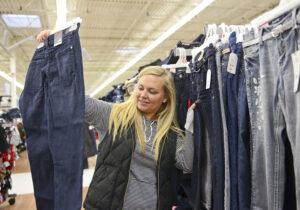 Senior Lexi Valentinas picks out clothes for Angel Tree recipients.