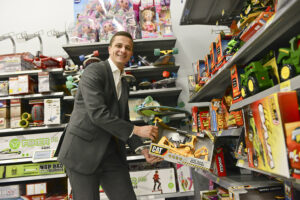SeniorAlex Nelsonselects toys for local children to receive as gifts for Christmas.