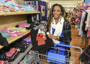 Student Aria Reel picks out clothes for the Angel Tree program.
