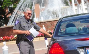 Security Officer Leads Students in Service