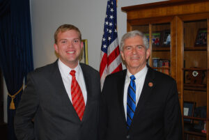 Adams with U.S. Rep. Daniel Webster.