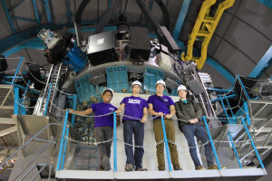 Marlowe, Hockett, Dr. Brad Barlow, assistant professor of astrophysics, and Filik stand next to the 4.2-meter SOAR telescope.