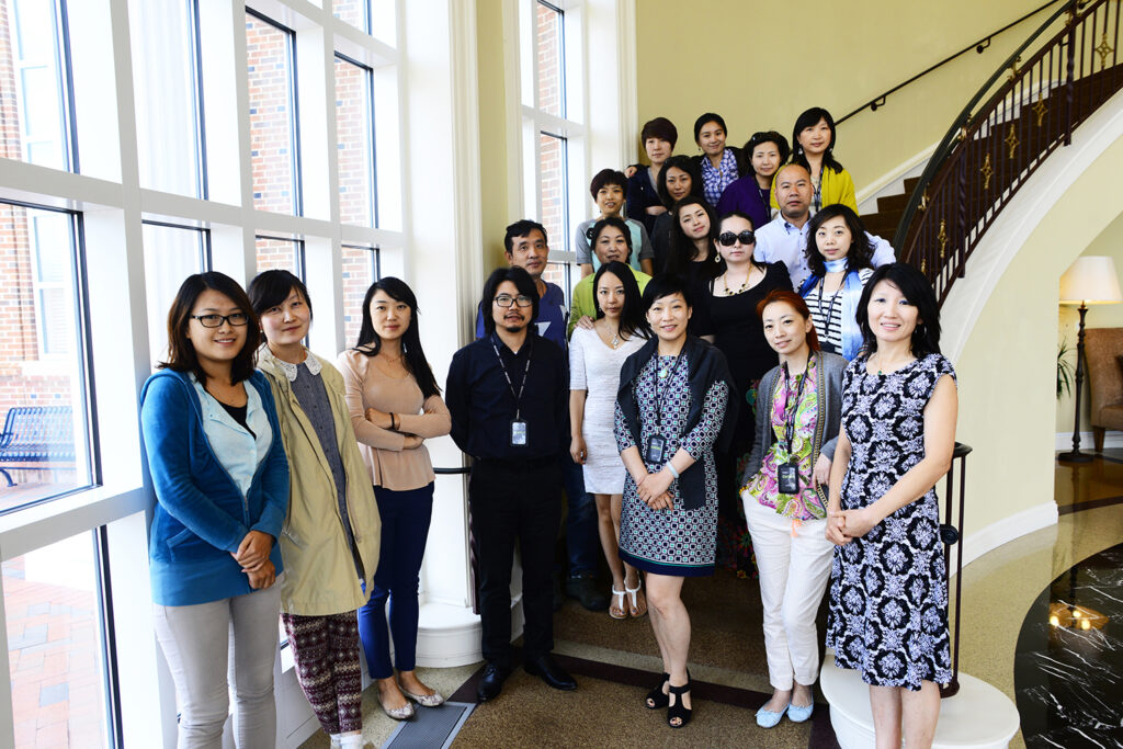 Interior designers visiting from China pause for a group photo at High Point University with Judy Danley, bottom right, instructor of Chinese and advisor for international students at HPU.