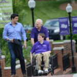 Smith and Greene walk through the HPU campus with Elliott.