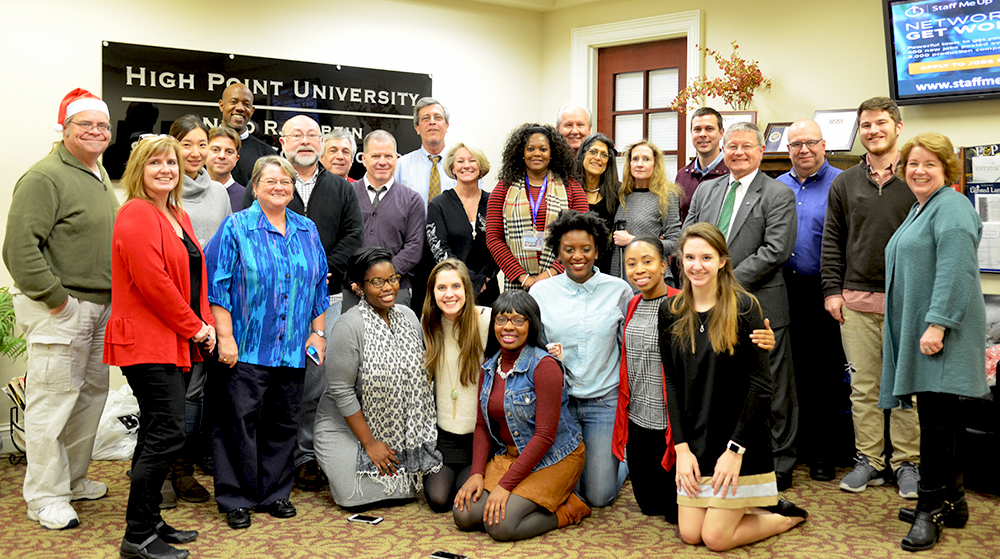 Members of HPU's Nido R. Qubein School of Communication give gifts to four families with Family Services of Davidson County