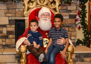 Children visit Santa for a photo during last year's event.