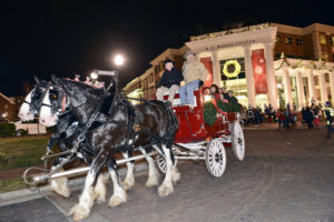 Community members enjoy a carriage ride drawn by Clydesdale horses during the first night of HPU's fourth annual Community Christmas.