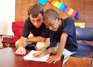 Junior Patrick Duggan reads with a second grader from High Point.
