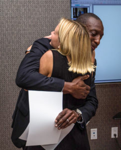 Corinne Eckert hugs retired Olympic sprinter Michael Johnson