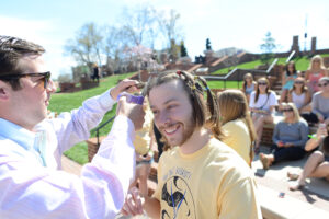 Senior Matt Jakubowski makes the initial cut on junior Kyler Bradley's locks.