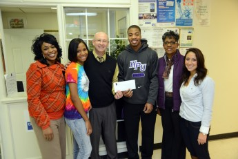 Diversity Club Helps Feed Hundreds with Donation to Open Door Ministries