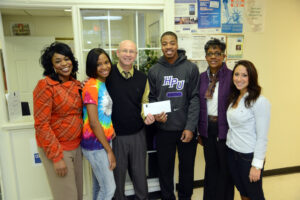 The Diversity Club donates a check of $850 dollars to Open Door Ministries.
