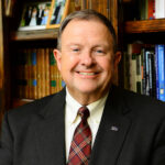 Dr. Dennis Carroll