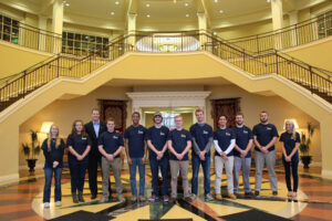 Pictured are members of the ENACTUS Club at High Point University. From left to right are students Christina Drake; Amanda Matlock; Dr. Tjai Nielsen, associate professor of management and advisor to the club at HPU; Jamison Orr; Jabari Harris; Louis McNinch; John Woods; Jeff Hughes; Andy Ricchini; Will Slemp; Stephen (Steve) Pollock; and Abby Derham.