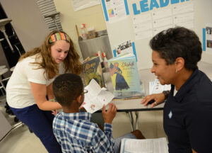 Tori Parshley (left) offers exercises designed to strengthen literacy skills to families at Florence Elementary.