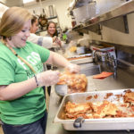 High Point University student Taylor Hemphill packages food for Open Door Ministries.