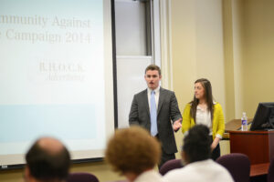 Alex Oberlander and Melissa Cattai present their marketing campaign for High Point Community Against Violence.