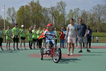 HPU Students Present Local Child with Specially Made Amtryke Bike