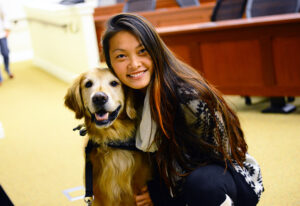 HPU student Anna Cheng poses with Hudson.