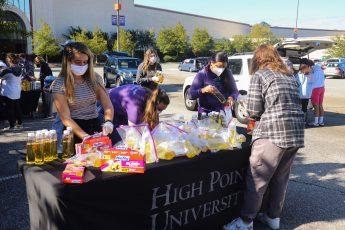 HPU's Biology Club Packs More Than 1,300 Science Kits for Community Children