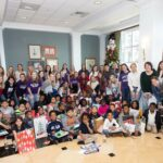 HPU Students reading with elementary students