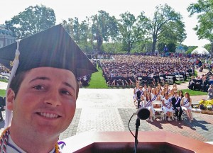 "Senior class president Matt Jakubowski takes a ""selfie"" with the entire Class of 2014 during his speech to graduates"