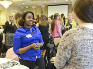 HPU student and Elect Her participant Tomeshia Spriggs shares her passions with fellow students for during an ice breaker exercise.