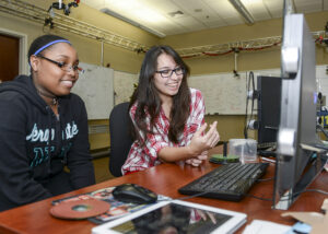 Godbolt and HPU student Kira Foglesong finalize their game creation together after working on it throughout the semester.