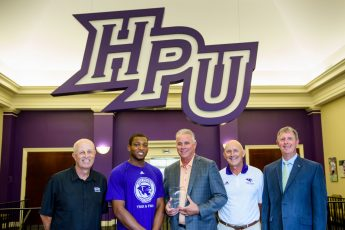 HPU Track Record-Breakers Callicutt and Stainback Celebrate Victory