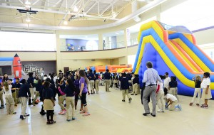 Students enjoy inflatable bounce houses and obstacle courses in the Slane Student Center.