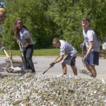 From left to right, High Point University pharmacy students Sonvia Brown, Charity Amenya, Craig Hall, Ryan Garner and Scott Vang shovel gravel to make a driveway at a Habitat for Humanity site in High Point.