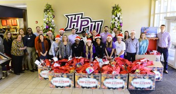 HPU Family Stuffs 1,000 Stockings for Salvation Army