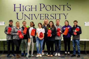 Students Stuff Stockings for Local Children