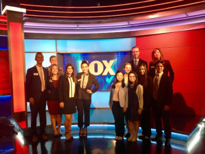 HPU in the City: Executives from Fox News Studios also offered the students a tour. On the left, beginning in the back, are Stone; Erica Burroughs, director of family engagement; Drass; Pusateri; and Becer. On the right, beginning in the back are Chris Dudley, senior vice president for Institutional Advancement; Bridget Holcombe, director of Career and Professional Development; Tellerd; Moss; Schorn; and Kaitlyn (left) and Kristen Doshier.