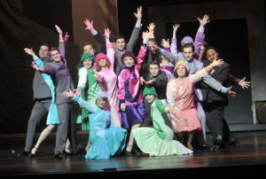 "The cast of ""Thoroughly Modern Millie"" poses following their performance."