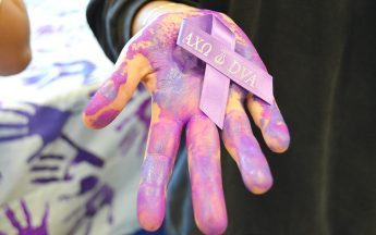 Sorority Pledges to End Domestic Violence One Hand at a Time