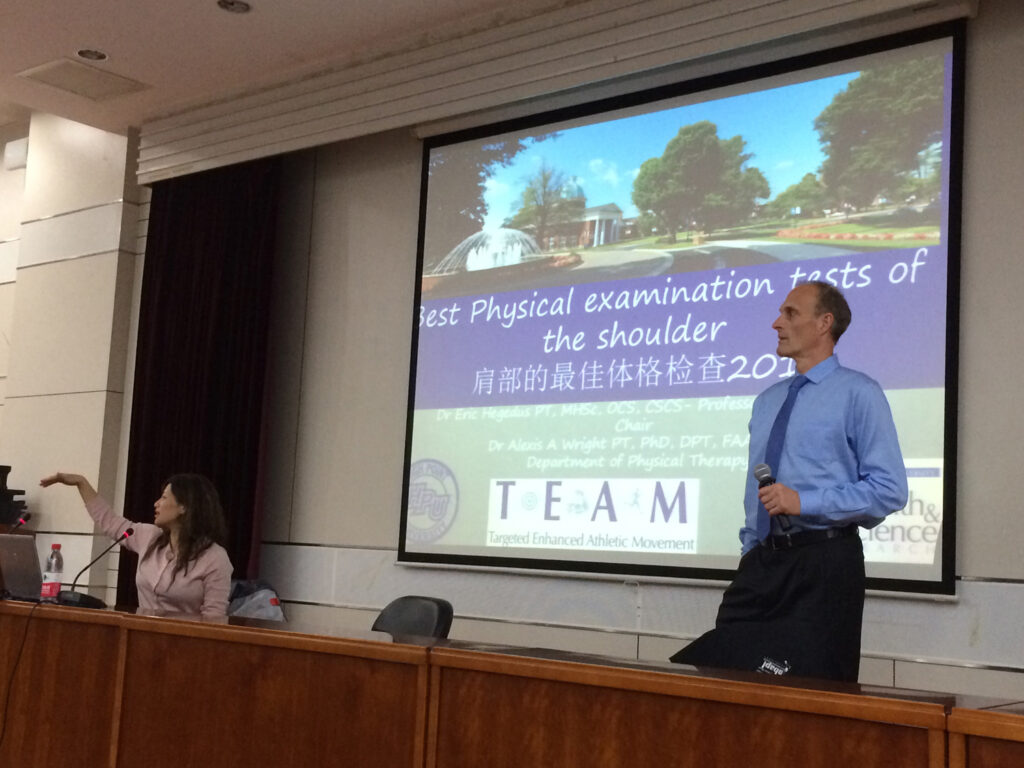 Hegedus presents at the Tianjin University of Sport to the university's dean, chair and students who are studying to become rehabilitation specialists.