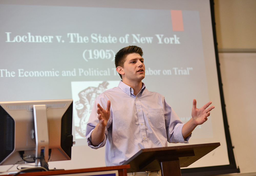 Student Sam Mjalli presents his research on the U.S. Supreme Court case Lochner v. New York.