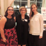 Samantha Davis, Dr. Jane Nichols and Hannah Rowell celebrate the students' award during the IFDA dinner.