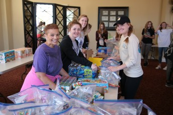 Impact Club Packs 3,000 Meals for Children in the Triad