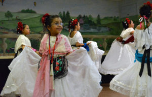 Jacqueline Zepeda, student dancer with the Latino Family Center Hispanic Folk Dance troupe, dances at the celebration last year.