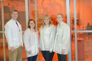 Pictured, from left to right, are Dr. Brian Augustine, chair of the HPU chemistry department; Caitlin Ferguson, sophomore; Stephanie Pettit, junior; and Dr. Briana Fiser, assistant professor of physics.