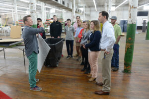 Blosser and his students tour the facilities of furniture manufacturer Buzzispace