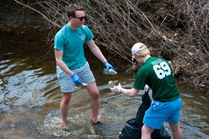 Anthony Vita and Josiah Howard collect waste from the waters.