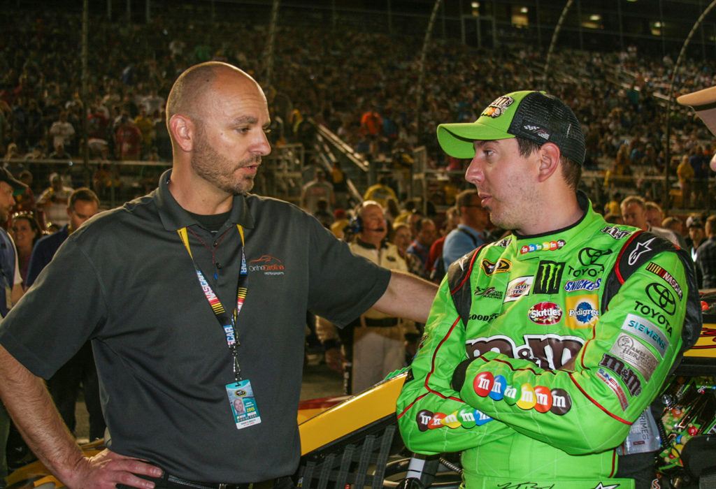 Breath (left) and NASCAR driver Kyle Busch at the May 2015 All-Star race in Charlotte, Busch's first race back in the car after his injury.