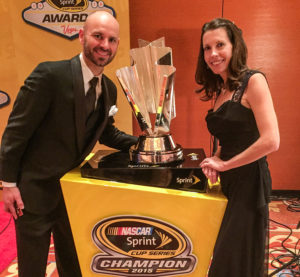 Breath and his wife, next to the trophy Kyle Busch won for winning the 2015 Sprint Cup Championship